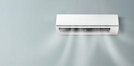 Single Split-Klimaanlage auf grauer Wand. Montage durch Kocer in Wien.